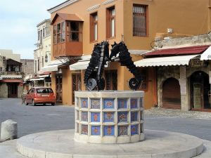 The fountain with three seahorses, Rhodes Custom Tours